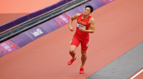 149925423 - Лю Сян сошёл с дистанции в забеге на 110 метров