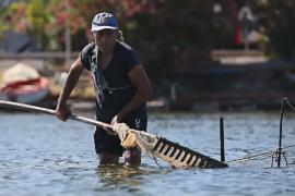 На сицилийском озере возродили добычу моллюсков