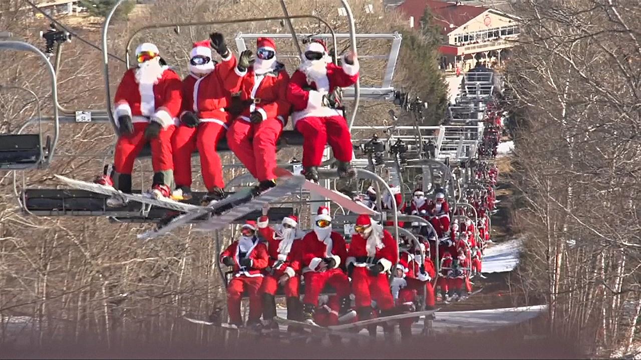 Десятки Санта-Клаусов съехали с горы на лыжах и сноубордах