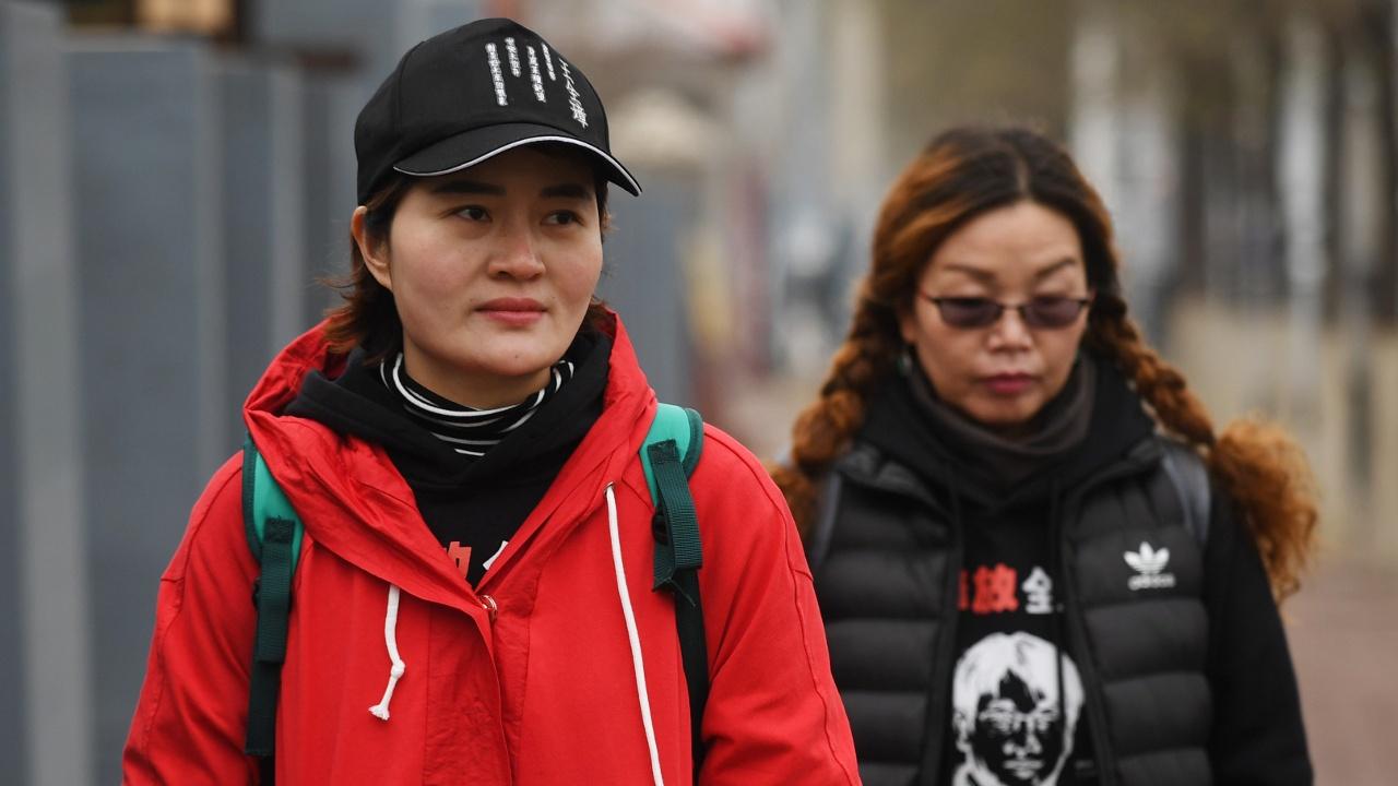 Жене заключённого китайского адвоката не дали завершить марш протеста