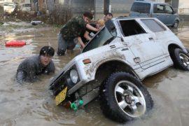 Жертв наводнений в Японии уже более 200
