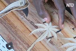 Камерунцы истребляют водяной гиацинт и превращают его в произведения искусства