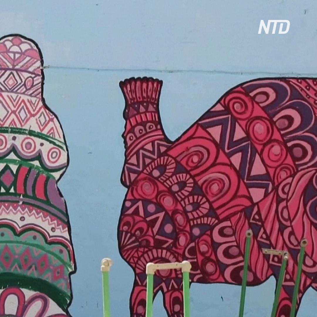 Художники разрисовывают разрушенный Мосул