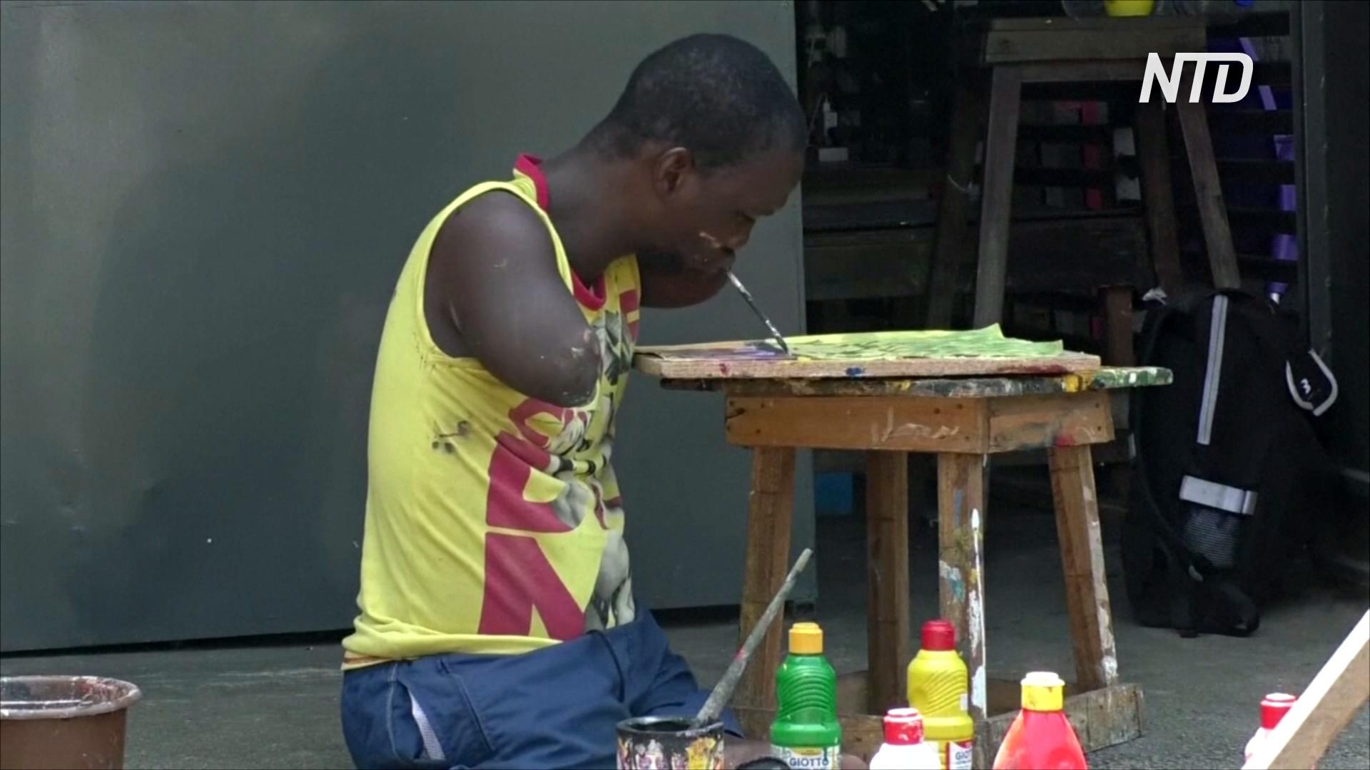 Художник без рук и ног из Кот-д'Ивуара рисует жизнерадостные пейзажи