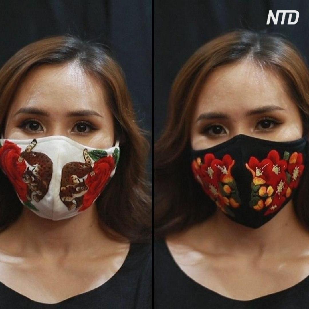 Во Вьетнаме медицинские маски украшают вышивкой