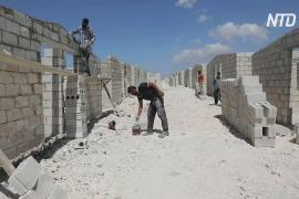 В Сирии для беженцев вместо палаток строят каменные дома