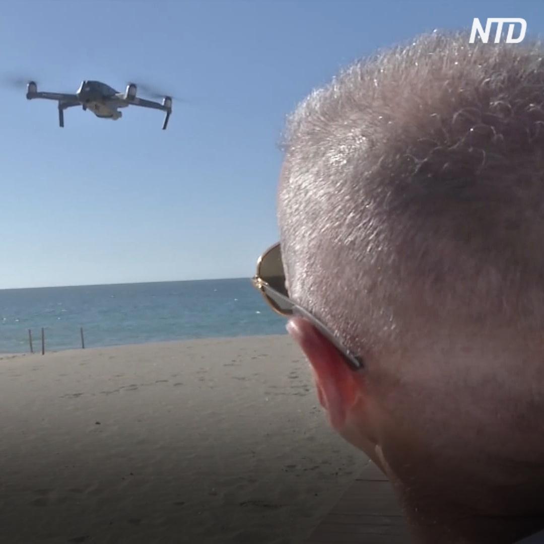 На пляжах Испании летает дрон и следит за соблюдением дистанции
