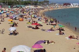 Барселонцы идут на пляжи, игнорируя призыв оставаться дома