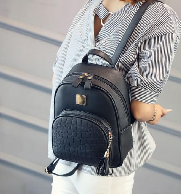 Женский рюкзак с текстурой каймана
