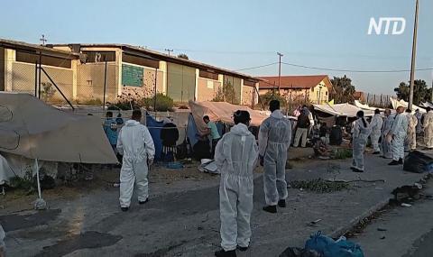 Полиция следит за перемещением сотен мигрантов на Лесбосе во временный лагерь