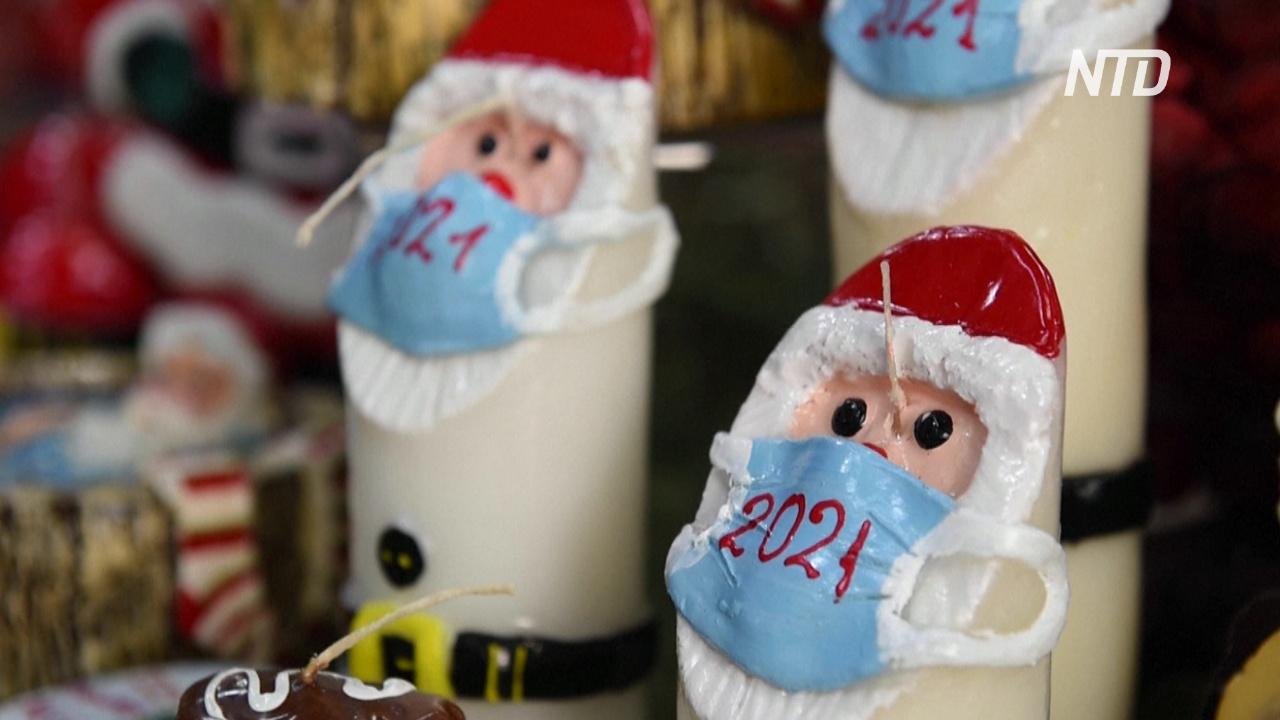В Греции свечи в виде Санты украсили медицинскими масками