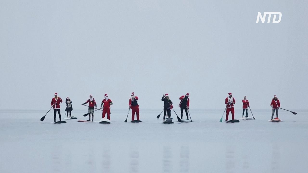 Санта-Клаусы устроили прогулку на SUP-бордах в Адриатическом море