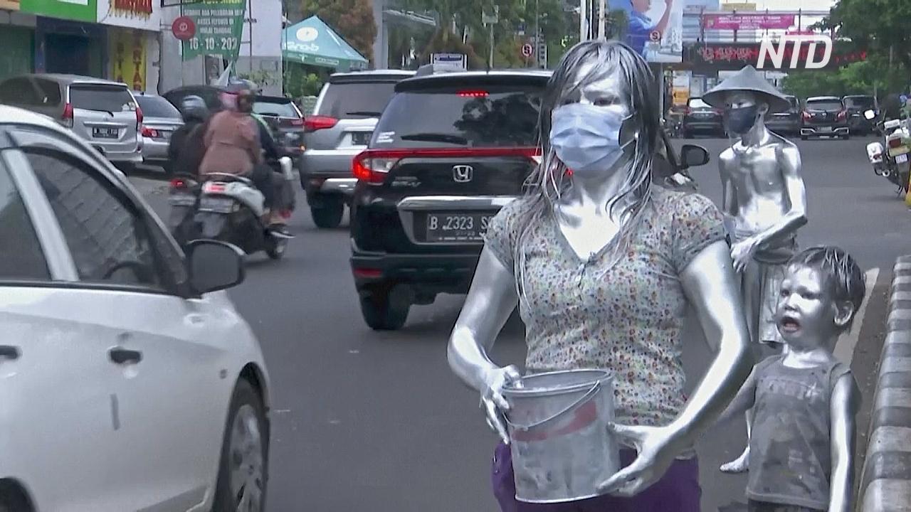«Серебряные люди» Индонезии выпрашивают деньги, чтобы прокормить семьи