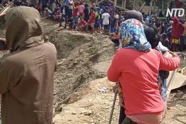 Оползень на руднике в Индонезии: десятки людей под завалами