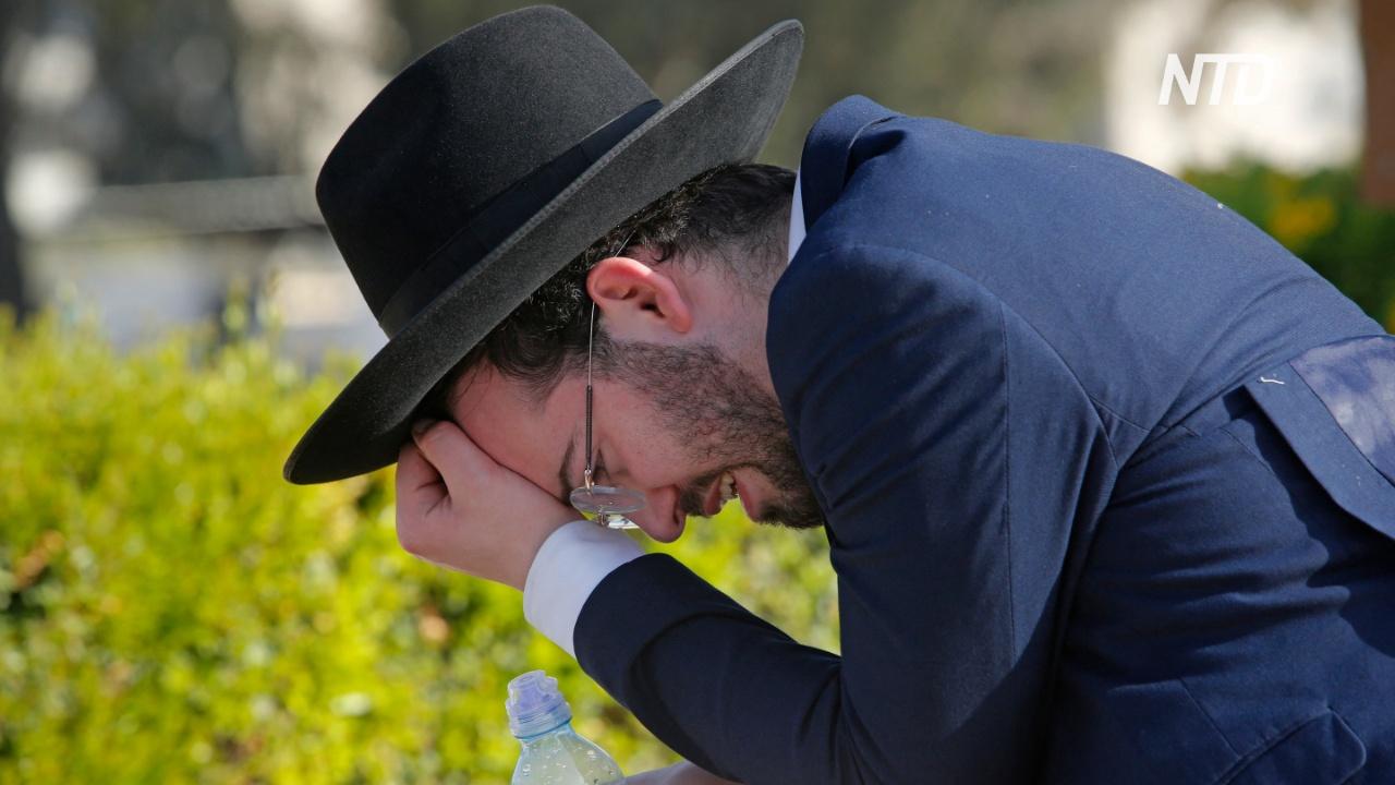 День траура: в Израиле помянули погибших на религиозном фестивале