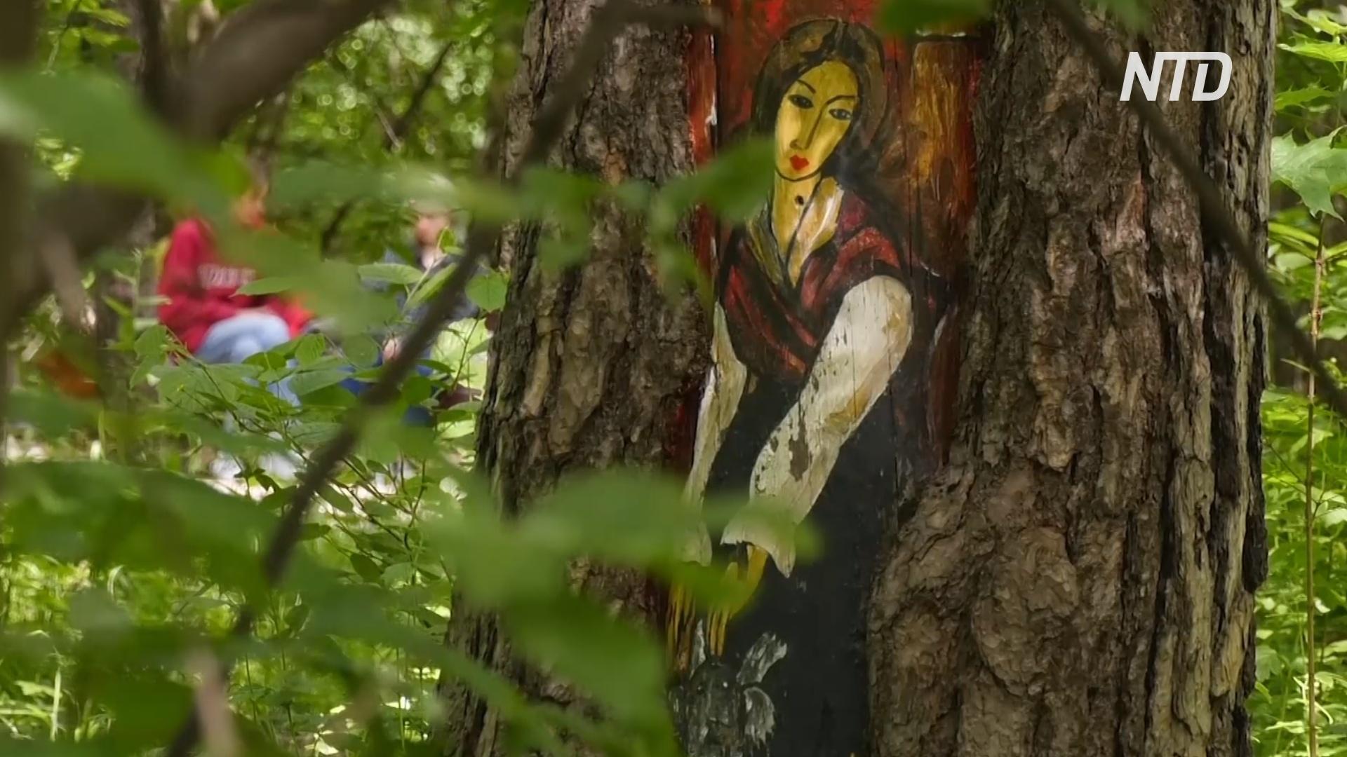 В парках Москвы повреждённые деревья украшают рисунками