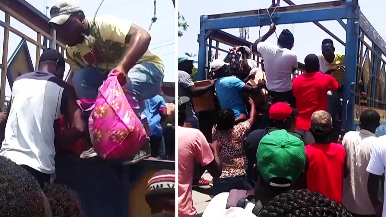 На Гаити люди грабят грузовики с едой после землетрясения