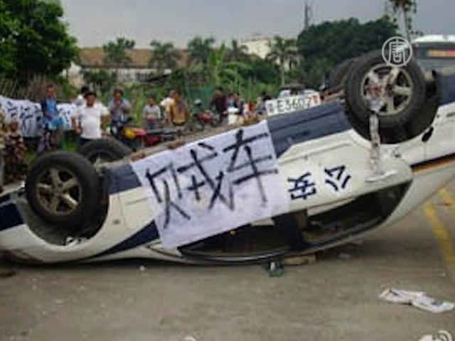 Полиция избила крестьян в провинции Гуандун