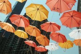 Зонтики предупреждают ньюйоркцев о риске рака кожи
