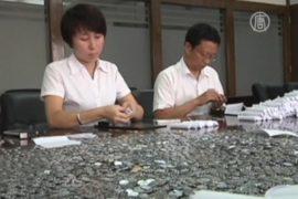 Банк 18 часов считал вклад китаянки в монетах