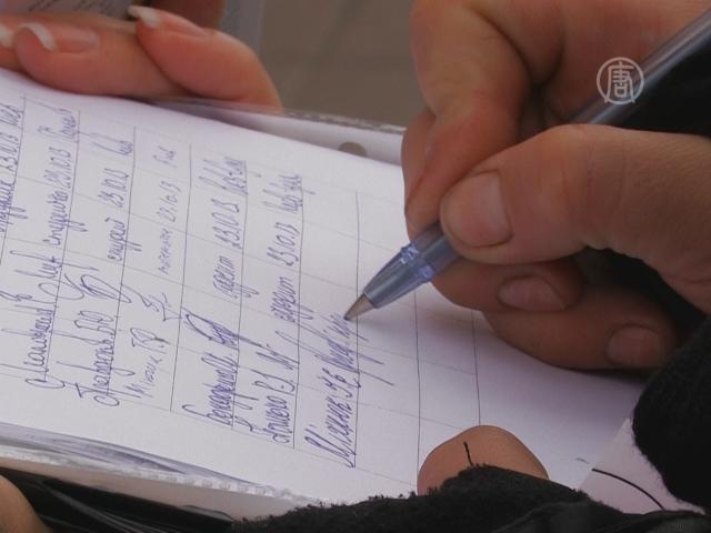 В центре Киева собирают подписи против убийств в КНР
