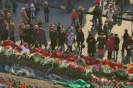 Майдан утонул в цветах скорби