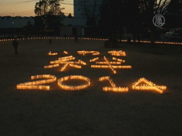 В Японии зажигают свечи в память о жертвах цунами