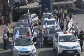 Таксисты Парижа атаковали «нелегальных» коллег