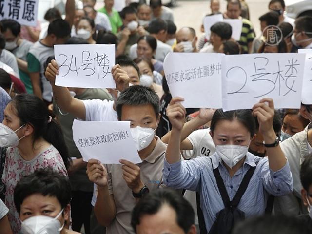 Жители Тяньцзиня требуют компенсаций