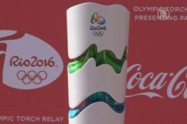 Факел Олимпиады стимулирует уборку на пляже в Рио