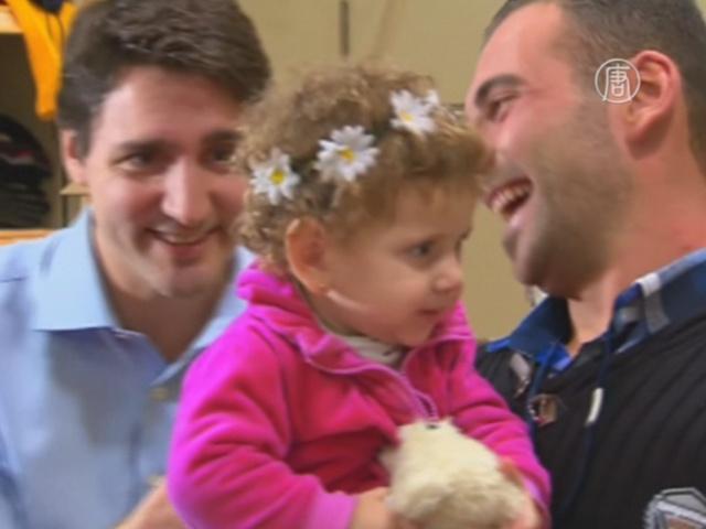 Премьер Канады встретил первых сирийских беженцев