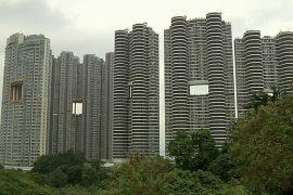 Почему в небоскрёбах Гонконга делают дыры?